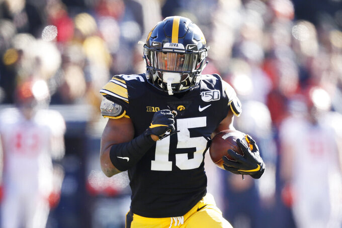 FILE - In this Nov. 23, 2019, file photo, Iowa running back Tyler Goodson carries the ball up field during the first half of an NCAA college football game against Illinois in Iowa City, Iowa. (AP Photo/Charlie Neibergall, File)