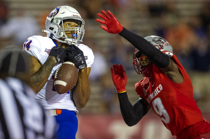 Houston Baptist wide receiver Vernon Harrell (14) fails to make a catch while defended by New Mexico safety Jerrick Reed (9) during the second half of an NCAA college football game Thursday, Sept. 2, 2021, in Albuquerque, N.M. (AP Photo/Andres Leighton)