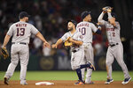 Houston Astros' Tyler Whie, Jose Altuve, Yuli Gurriel and Alex Bregman, from left, celebrate a 6-2 win over the Los Angeles Angels in a baseball game in Anaheim, Calif., Thursday, July 18, 2019. (AP Photo/Kyusung Gong)