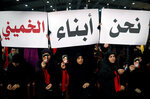 FILE - In this Feb. 6, 2019 file photo, Hezbollah supporters hold up Arabic placards that read,