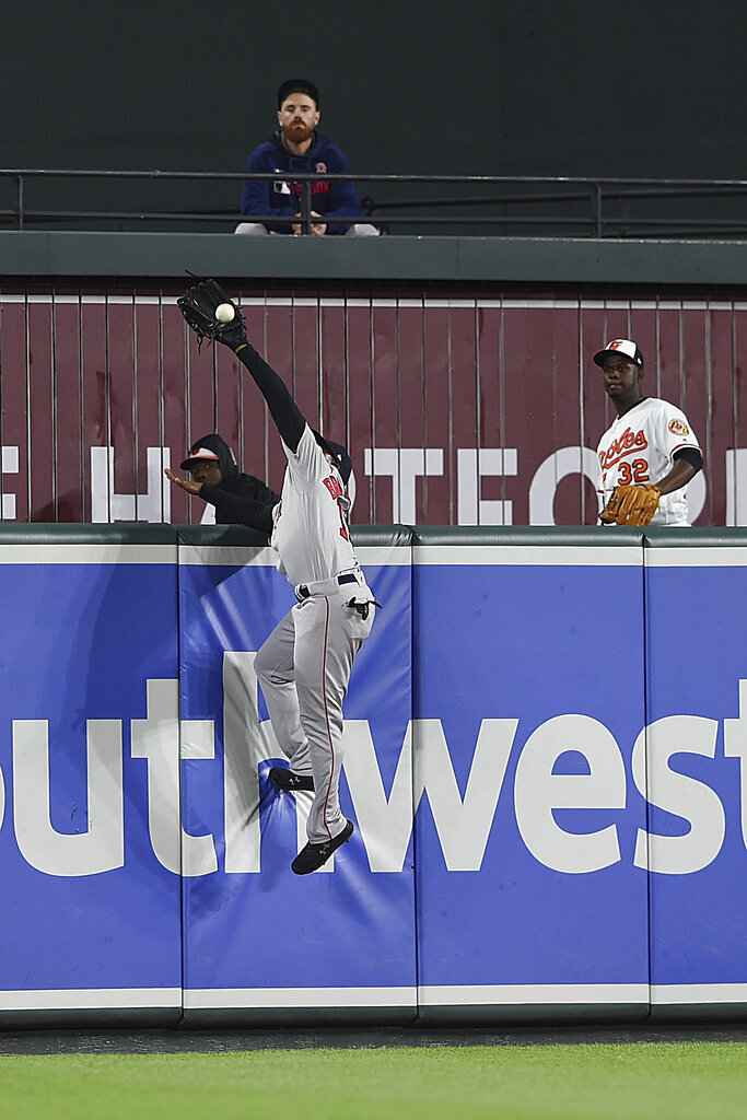 Boston Red Sox center fielder Jackie Bradley Jr. robs Baltimore Orioles' Trey Mancini of a home run in the 11th inning of a baseball game Wednesday, May 8, 2019, in Baltimore. The Red Sox won 2-1 in 12 innings. (AP Photo/Gail Burton)