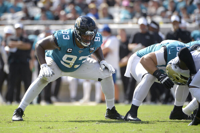 FILE - In this Oct. 13, 2019, file photo, then-Jacksonville Jaguars defensive end Calais Campbell (93) sets up to block on a field goal attempt during the second half of an NFL football game against the New Orleans Saints, in Jacksonville, Fla. By trading for Calais Campbell and signing free agent Derek Wolfe, the Baltimore Ravens shored up a line that was pierced for 217 yards rushing in a playoff loss to Tennessee. (AP Photo/Phelan M. Ebenhack, File)