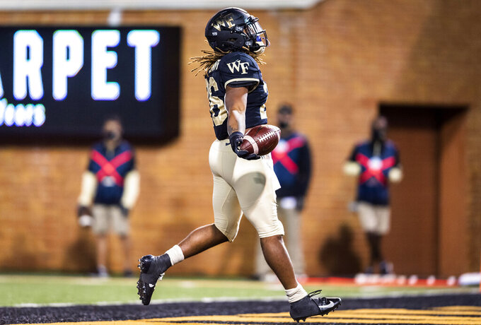 Wake Forest running back Christian Beal-Smith (26) celebrates his touchdown against Campbell during an NCAA college football game Friday, Oct. 2, 2020, in Winston-Salem, N.C. (Andrew Dye/The Winston-Salem Journal via AP)
