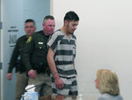 Wilber Martinez-Guzman is escorted into Carson City Justice Court on Friday, Feb. 8, 2019, before his preliminary hearing was postponed on multiple counts stemming from his alleged murder of four people in northern Nevada last month. The 20-year-old Salvadoran immigrant waived his right to speedy proceedings in Carson City on burglary charges related to items stolen from some of the victims. Prosecutors say he's expected to be extradited to Reno next week to face four murder counts first. (AP Photo/Scott Sonner)