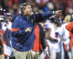 Mississippi coach Matt Luke gestures during the team's NCAA college football game against Mississippi State on Thursday, Nov. 28, 2019, in Starkville, Miss. (Bruce Newman/The Oxford Eagle via AP)