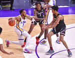 LSU guard Javonte Smart (1) drives past South Carolina guard TJ Moss (1) and South Carolina guard AJ Lawson (00), during an NCAA college basketball game, Saturday, Jan. 16, 2021, in Baton Rouge, La.  (Hilary Scheinuk/The Advocate via AP)
