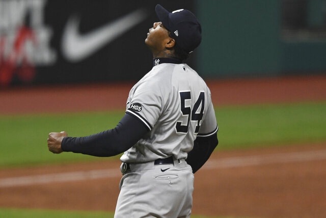 New York Yankees relief pitcher Aroldis Chapman reacts after the Yankees defeated the Cleveland Indians 10-9 in Game 2 of an American League wild-card baseball series, early Thursday, Oct. 1, 2020, in Cleveland. (AP Photo/David Dermer)