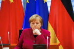 German Chancellor Angela Merkel attends virtual talks with Chinese Premier Li Keqiang (not seen) as part of the Sixth German-Chinese Government Consultations, in Berlin, Germany April 28, 2021. (Michele Tantussi/Pool via AP)