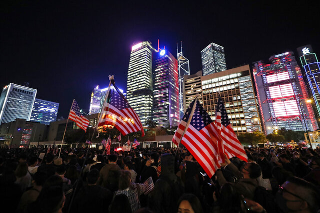 "Protester holds U.S. flags during a demonstration in Hong Kong, Thursday, Nov. 28, 2019. China's fury over President Donald Trump's decision to sign legislation supporting human rights in Hong Kong is evident. What's less clear what ""countermeasures"" Beijing may take in response to what it said Thursday were ""extremely evil"" and dangerous moves. (AP Photo/Vincent Thian)"