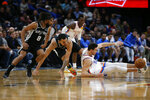 Oklahoma City Thunder's Danilo Gallinari (8) fights for the ball with San Antonio Spurs' Trey Lyles (41) and Patty Mills (8) while Dennis Schroder (17) looks on during the second half of an NBA basketball game in Oklahoma City, Tuesday, Feb. 11, 2020. (AP Photo/Garett Fisbeck)