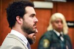 Mexican soap opera star Pablo Lyle, left, appears in court with his attorneys during his hearing, Wednesday, Jan. 22, 2020, in Miami. Florida Judge Marlene Fernandez-Karavetsos says that the Mexican actor won't be able to return to his native country while he awaits trial on a charge he fatally punched a man during a road-rage confrontation. (Carl Juste/Miami Herald via AP, Pool)