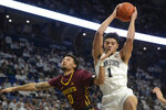 Penn State's Seth Lundy (1) comes down with a rebound in front of Minnesota's Payton Willis (0) during first-half action of an NCAA college basketball game, Saturday, Feb. 8, 2020, in State College, Pa. (AP Photo/Gary M. Baranec)