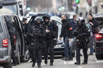 French police forces take position in the Neudorf district of Strasbourg, eastern France, Thursday, Dec. 13, 2018. French security forces were trying to catch the suspected Strasbourg gunman dead or alive as the city of Strasbourg was still in mourning with candles lit and flowers left at the site of Tuesday's attack near the Christmas market.(AP Photo/Jean-Francois Badias)