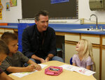 CLARIFIES INSURANCE COMPANIES DECLINED TO RENEW NEARLY 350,000 HOME INSURANCE POLICIES Gov. Gavin Newsom ponders a question by kindergartner Kali Pello during his visit to the Paradise Ridge Elementary School in Paradise, Calif., Wednesday, Aug. 21, 2019. Newsom toured the school and visited with students and teachers that just returned to school last week from the summer break in the community that was ravaged by last year's Camp Fire. New California data shows insurance companies declined to renew nearly 350,000 home insurance policies in areas at high risk for wildfire since the state began collecting date in 2015. (AP Photo/Rich Pedroncelli, Pool)