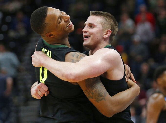 Baylor guards Makai Mason, right, and Mark Vital (11) hug following the team's win over Syracuse in a first-round game in the NCAA men's college basketball tournament Thursday, March 21, 2019, in Salt Lake City. (AP Photo/Rick Bowmer)