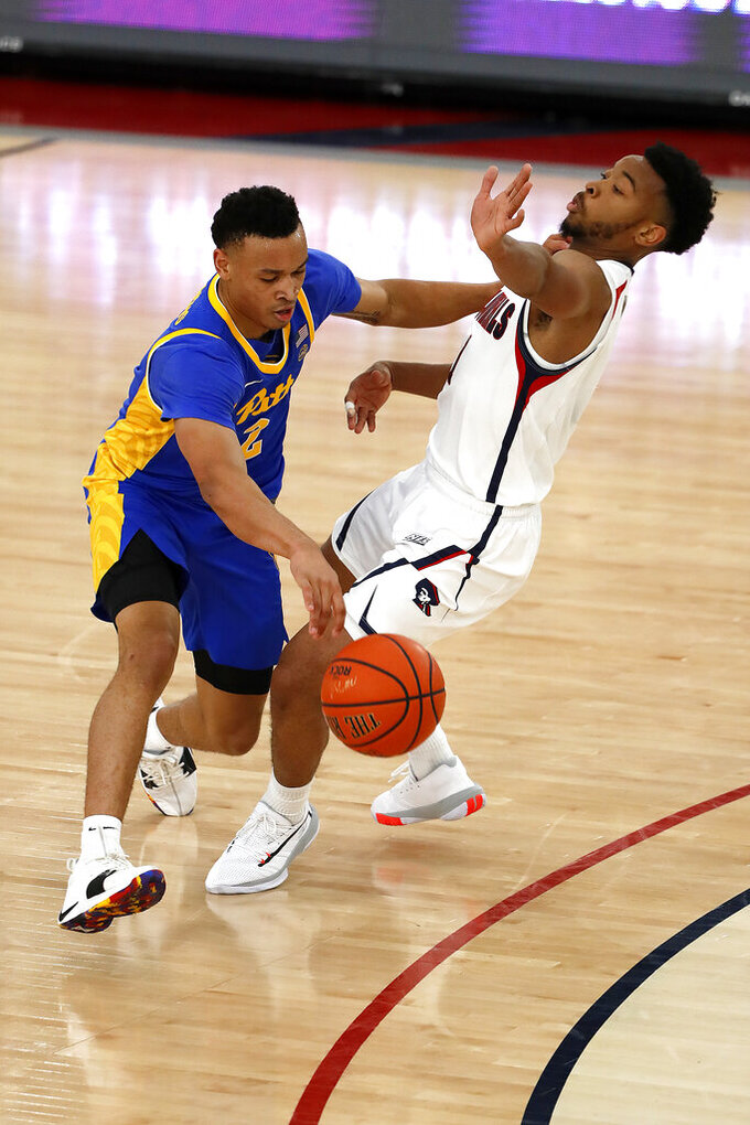 Pittsburgh's Trey McGowens (2) drives for the basket with Robert Morris' Jon Williams defending during the second half of an NCAA college basketball game in Pittsburgh, Tuesday, Nov. 12, 2019. Pittsburgh won 71-57. (AP Photo/Gene J. Puskar)