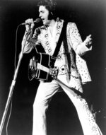 In this undated photo, Elvis Presley is shown performing at an unknown location. Elvis Presley's longtime friend and radio personality George Klein has died at age 83. Presley's former wife, Priscilla Presley, told The Associated Press that Klein died Tuesday, Feb. 5, 2019, at hospice in Memphis, Tenn. She said Klein had been suffering from illness, including pneumonia, for about two weeks. (AP Photo, File)