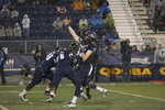 Nevada quarterback Carson Strong (12) passes the ball in the rain against Hawaii in the first half of an NCAA college football game in Reno, Nev., Saturday, Sept. 28, 2019. (AP Photo/Tom R. Smedes)