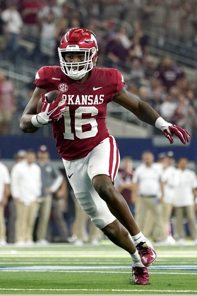 Arkansas wide receiver Treylon Burks gains yardage carrying the ball in the second half of an NCAA college football game against Texas A&M in Arlington, Texas, Saturday, Sept. 25, 2021. (AP Photo/Tony Gutierrez)