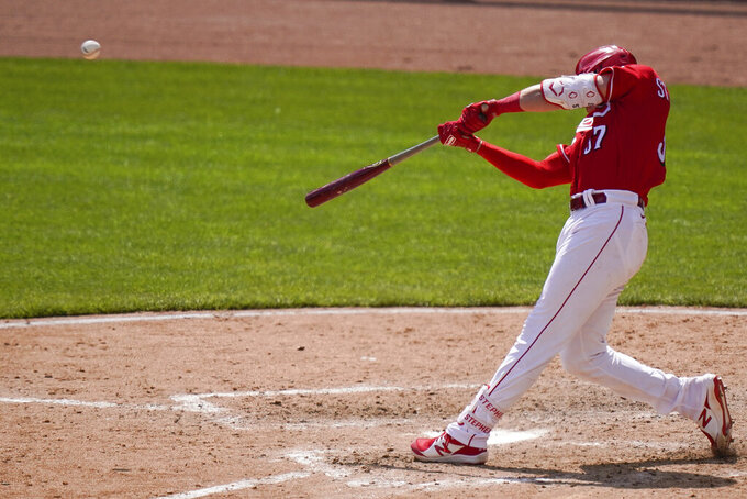 Cincinnati Reds' Tyler Stephenson hits a home run during the eighth inning of a baseball game against the Pittsburgh Pirates at Great American Ball Park in Cincinnati, Wednesday, April 7, 2021. (AP Photo/Bryan Woolston)