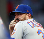 New York Mets manager Mickey Callaway (36) looks on from the dugout during a baseball game against the Atlanta Braves Wednesday, June 19, 2019, in Atlanta. (AP Photo/John Bazemore)
