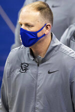 Creighton assistant coach Alan Huss watches the team warm up before playing Butler in an NCAA college basketball game Saturday, March 6, 2021, in Omaha, Neb. Coach Greg McDermott was suspended Thursday. (Chris Machian/Omaha World-Herald via AP)