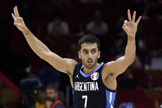 FILE - In this Sept. 4, 2019, file photo, Facundo Campazzo of Argentina celebrates after a teammate's 3-pointer against Russia during their Group B match in the FIBA Basketball World Cup at the Wuhan Sport Center in Wuhan in central China's Hubei province. Campazzo agreed to a two-year deal with the Denver Nuggets on Friday, Nov. 20, 2020, the opening day of free agency, according to a person with direct knowledge of the deal. The person spoke to The Associated Press on condition of anonymity because the contract remains unfinished until at least Sunday, when the NBA moratorium on new signings will be lifted. (AP Photo/Andy Wong, File)