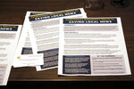 In this July 31, 2019, photo shows flyers that were passed out at a meeting Congressman Mark DeSaulnier held on saving local news in San Francisco.