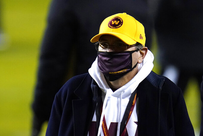 FILE - In this Jan. 9, 2021, file photo, Washington Football Team owner Daniel Snyder walks on the field prior to an NFL wild-card playoff football game against the Tampa Bay Buccaneers in Landover, Md. Twenty female former Washington Football Team employees are calling on NFL Commissioner Roger Goodell to release the final report of an independent investigation into the organization's conduct. The employees and their lawyers sent letters to Goodell on Thursday, Feb. 25, 2021, making the request. Snyder hired Beth Wilkinson to investigate in July after former employees made allegations of workplace sexual harassment. (AP Photo/Julio Cortez, File)