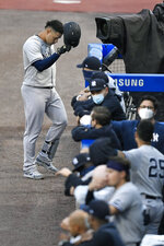 New York Yankees' Gary Sanchez, top, walks back to the dugout after grounding out to Toronto Blue Jays third baseman Joe Panik during the second inning of a baseball game in Buffalo, N.Y., Tuesday, Sept. 8, 2020. (AP Photo/Adrian Kraus)