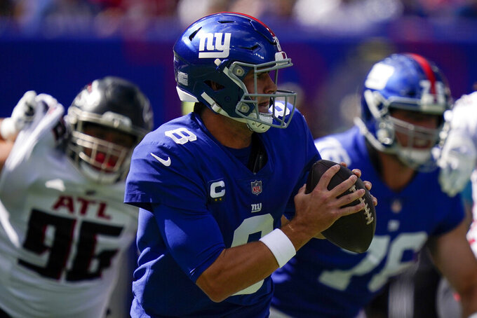 New York Giants quarterback Daniel Jones (8) looks to pass on the run during the first half of an NFL football game against the Atlanta Falcons, Sunday, Sept. 26, 2021, in East Rutherford, N.J. (AP Photo/Seth Wenig)