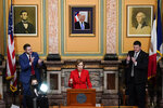 Iowa Gov. Kim Reynolds delivers her Condition of the State address before a joint session of the Iowa Legislature, Tuesday, Jan. 12, 2021, at the Statehouse in Des Moines, Iowa. (AP Photo/Charlie Neibergall)