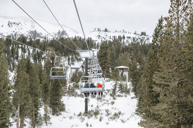 This photo provided by Mammoth Mountain Ski Area shows skiers on a chair lift on opening day of the Mammoth Mountain Ski Area, Calif., Friday, Nov. 13, 2020. Rain moved across Northern California and snow began falling in the northern Sierra Nevada on Friday. The latest storm came a week after California finally got a real dose of fall weather after months of hot, dry conditions that fed wildfires. (Peter Morning/Mammoth Mountain Ski Area via AP)