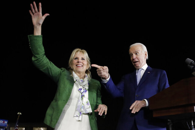 FILE - In this Mar. 3, 2020, file photo, Democratic presidential candidate former Vice President Joe Biden, right, and his wife Jill attend a primary election night rally in Los Angeles. The Democratic Party's attempt to adapt its typical convention rituals to a pandemic-induced virtual affair will be put through its paces Tuesday night. (AP Photo/Marcio Jose Sanchez, File)