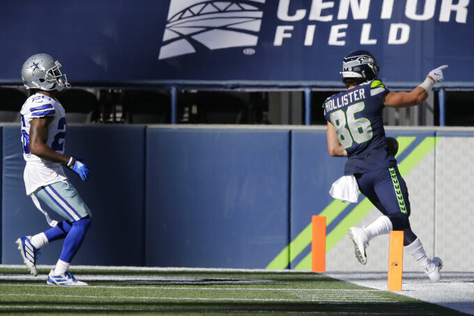 Seattle Seahawks tight end Jacob Hollister, right scores a touchdown past Dallas Cowboys cornerback Daryl Worley, left, during the second half of an NFL football game, Sunday, Sept. 27, 2020, in Seattle. (AP Photo/John Froschauer)