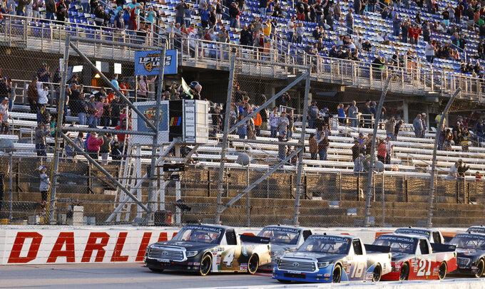 John Hunter Nemechek (4) leads the field to start the NASCAR Truck Series auto race at Darlington Raceway, Friday, May 7, 2021, in Darlington, S.C. (AP Photo/Terry Renna)
