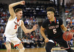 Gardner-Webb's Jose Perez (5) drives against Virginia's Kyle Guy during a first-round game in the NCAA men's college basketball tournament in Columbia, S.C., Friday, March 22, 2019. (AP Photo/Richard Shiro)