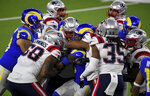 Los Angeles Rams running back Cam Akers (23) is swarmed by New England Patriots in the first half of an NFL football game in Inglewood, Calif., Thursday, Dec. 10, 2020. (Keith Birmingham/The Orange County Register via AP)