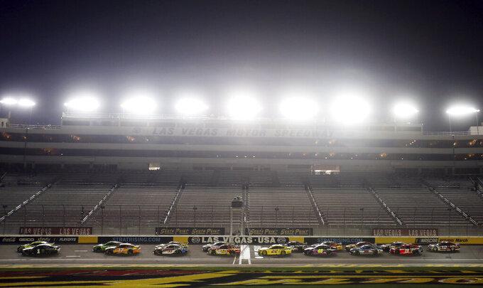 Kurt Busch (1) leads during a restart during a NASCAR Cup Series auto race, Sunday, Sept. 27, 2020, in Las Vegas. (AP Photo/Isaac Brekken)