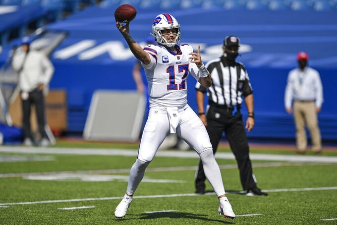 Buffalo Bills quarterback Josh Allen (17) throws a pass to Lee Smith (85) for a touchdown during the first half of an NFL football game against the Los Angeles Rams Sunday, Sept. 27, 2020, in Orchard Park, N.Y. (AP Photo/Adrian Kraus)