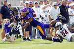 East Carolina's C.J. Johnson (5) catches the ball and remains inbounds as South Carolina's Marcellas Dial (24) looks on during the second half of an NCAA college football game in Greenville, N.C., Saturday, Sept. 11, 2021. (AP Photo/Karl B DeBlaker)