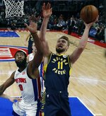 Indiana Pacers forward Domantas Sabonis (11) is defended by Detroit Pistons center Andre Drummond (0) during the first half of an NBA basketball game, Wednesday, April 3, 2019, in Detroit. (AP Photo/Carlos Osorio)