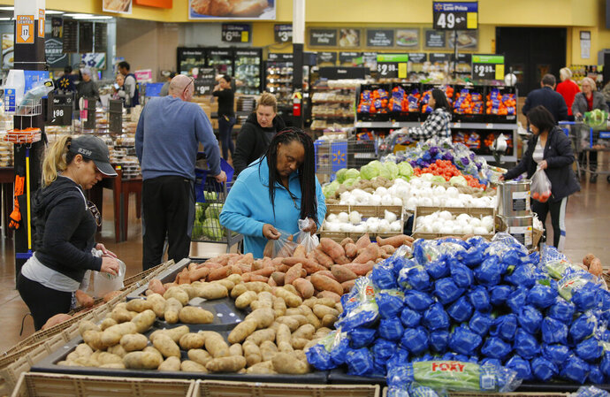 FILE - In this Nov. 27, 2019, file photo people shop for food the day before the Thanksgiving holiday at a Walmart Supercenter in Las Vegas. On Wednesday, Dec. 11, the Labor Department reports on U.S. consumer prices for November. (AP Photo/John Locher, File)