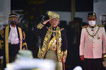In this photo released by Malaysia's Department of Information, Malaysia's King Sultan Abdullah Sultan Ahmad Shah, center, salutes during the opening ceremony of the  parliamentary session at parliament house in Kuala Lumpur, Monday, May 18, 2020. Malaysia's King said Wednesday, June 16, 2021, that Parliament, which has been suspended under a coronavirus emergency since January, must resume as soon as possible but stopped short of saying the emergency should end. (Shaiful Nizal Ismail/Malaysia's Department of Information via AP)