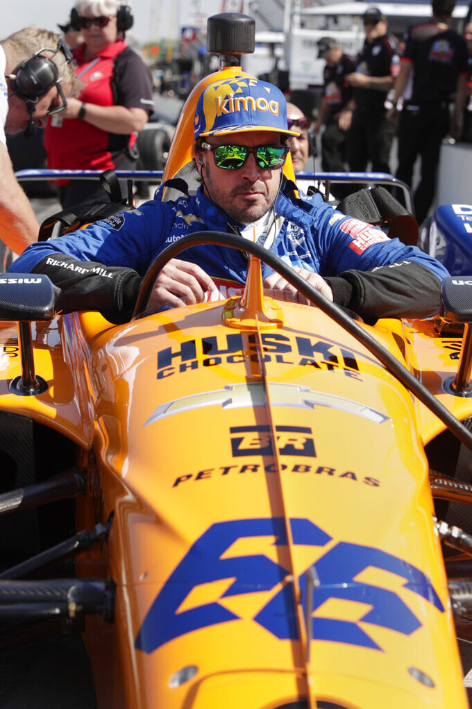 Fernando Alonso, of Spain, climbs into his car during practice for the Indianapolis 500 IndyCar auto race at Indianapolis Motor Speedway, Wednesday, May 15, 2019, in Indianapolis. (AP Photo/Michael Conroy)