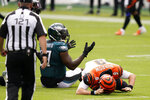 Cincinnati Bengals' Joe Burrow (9) reacts after a hit by Philadelphia Eagles' Malik Jackson (97) during the first half of an NFL football game, Sunday, Sept. 27, 2020, in Philadelphia. (AP Photo/Chris Szagola)