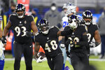 Baltimore Ravens inside linebacker Patrick Queen (48) reacts after making an interception on a pass from Dallas Cowboys quarterback Andy Dalton during the first half of an NFL football game, Tuesday, Dec. 8, 2020, in Baltimore. (AP Photo/Nick Wass)
