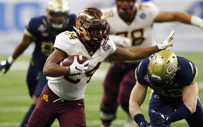 Minnesota running back Mohamed Ibrahim rushes during the second half of the Quick Lane Bowl NCAA college football game against Georgia Tech, Wednesday, Dec. 26, 2018, in Detroit. (AP Photo/Carlos Osorio)