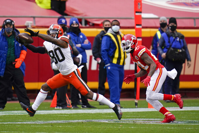 Cleveland Browns wide receiver Jarvis Landry (80) catches a pass ahead of Kansas City Chiefs cornerback Bashaud Breeland, right, during the first half of an NFL divisional round football game, Sunday, Jan. 17, 2021, in Kansas City. (AP Photo/Jeff Roberson)