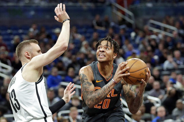 Orlando Magic guard Markelle Fultz, right, looks for a shot against Brooklyn Nets guard Dzanan Musa during the first half of an NBA basketball game, Monday, Jan. 6, 2020, in Orlando, Fla. (AP Photo/John Raoux)